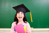 happy girl wear a graduation hat with blackboard