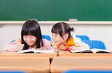 cute little student  look her classmate homework