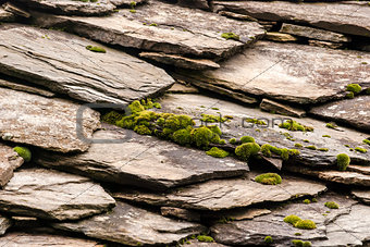 Stone tiles of slate-roof house