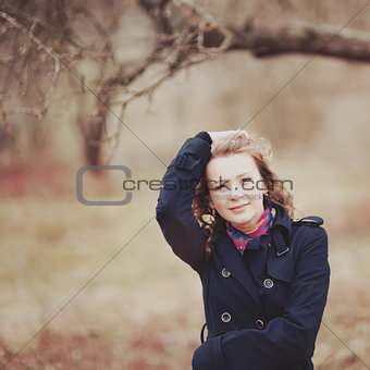 Curly hair spring girl in coat.