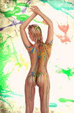 blond nude girl with multicolored body paint over her body