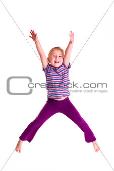 studio shot of young girl jumping