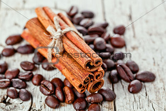 stack of cinnamon sticks and coffee beans