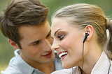 beautiful couple listening player