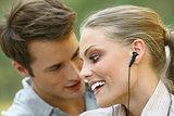 beautiful couple listening player