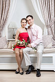 Happy young couple in luxury interior