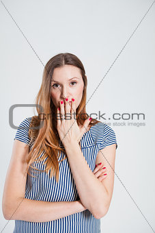 Attractive woman covering mouth with hand
