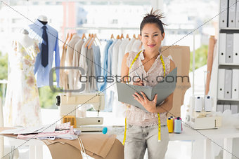 Beautiful female fashion designer with folder