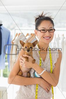 Beautiful female fashion designer with chihuahua