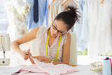 Concentrated fashion designer working on fabrics
