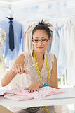 Female fashion designer working on fabrics