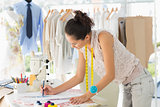 Female fashion designer working on her designs