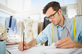 Fashion designer working on his designs