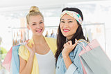 Portrait of young women with shopping bags