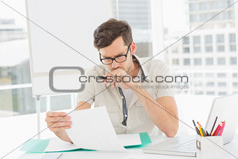 Casual young man reading document