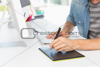 Casual male photo editor using graphics tablet
