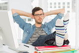 Relaxed casual young man with legs on desk