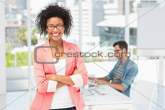 Casual female artist with colleague in the background