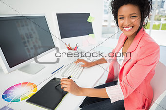 Casual female photo editor using computer