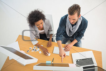 Young couple working on computer in office