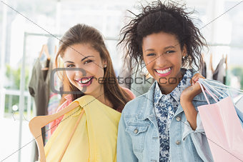 Portrait of two happy young women with shopping bags