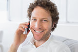 Closeup portrait of a smiling man using mobile phone