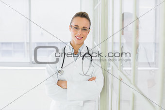 Beautiful female doctor with arms crossed in hospital
