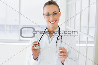 Beautiful female doctor with stethoscope in hospital