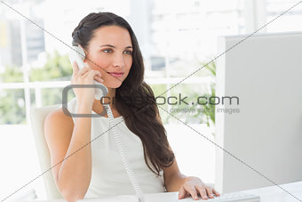 Beautiful businesswoman on telephone at her desk