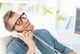 Handsome designer laughing on the telephone