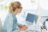 Blonde designer working at her desk