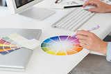 Designer working at her desk using a colour wheel