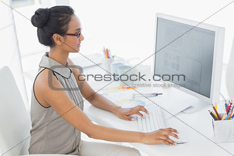 Designer working at her desk using computer