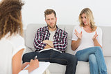 Woman speaking to therapist at couples therapy