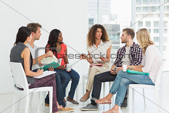 Therapist speaking to a rehab group