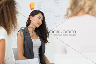 Asian woman listening at a meeting