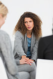 Concerned woman comforting another in rehab group at therapy