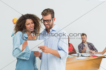 Attractive designers looking at tablet pc