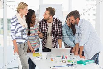 Focused team of designers having a meeting