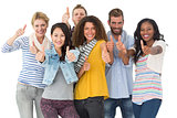 Happy group of young friends giving thumbs up to camera