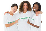 Attractive team of volunteers smiling at camera