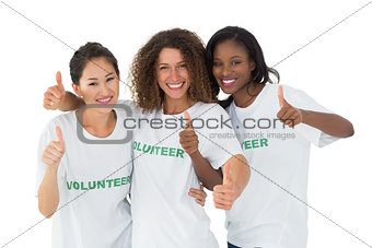 Attractive team of volunteers giving thumbs up at camera