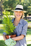 Woman holding potted plant for gardening