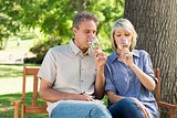 Couple drinking wine in park