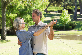 Couple dancing in countryside