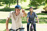 Couple enjoying bike ride in park
