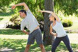 Couple doing stretching exercise