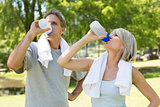 Couple drinking water after workout