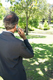Businessman using cellphone