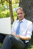 Confident mature businessman with laptop